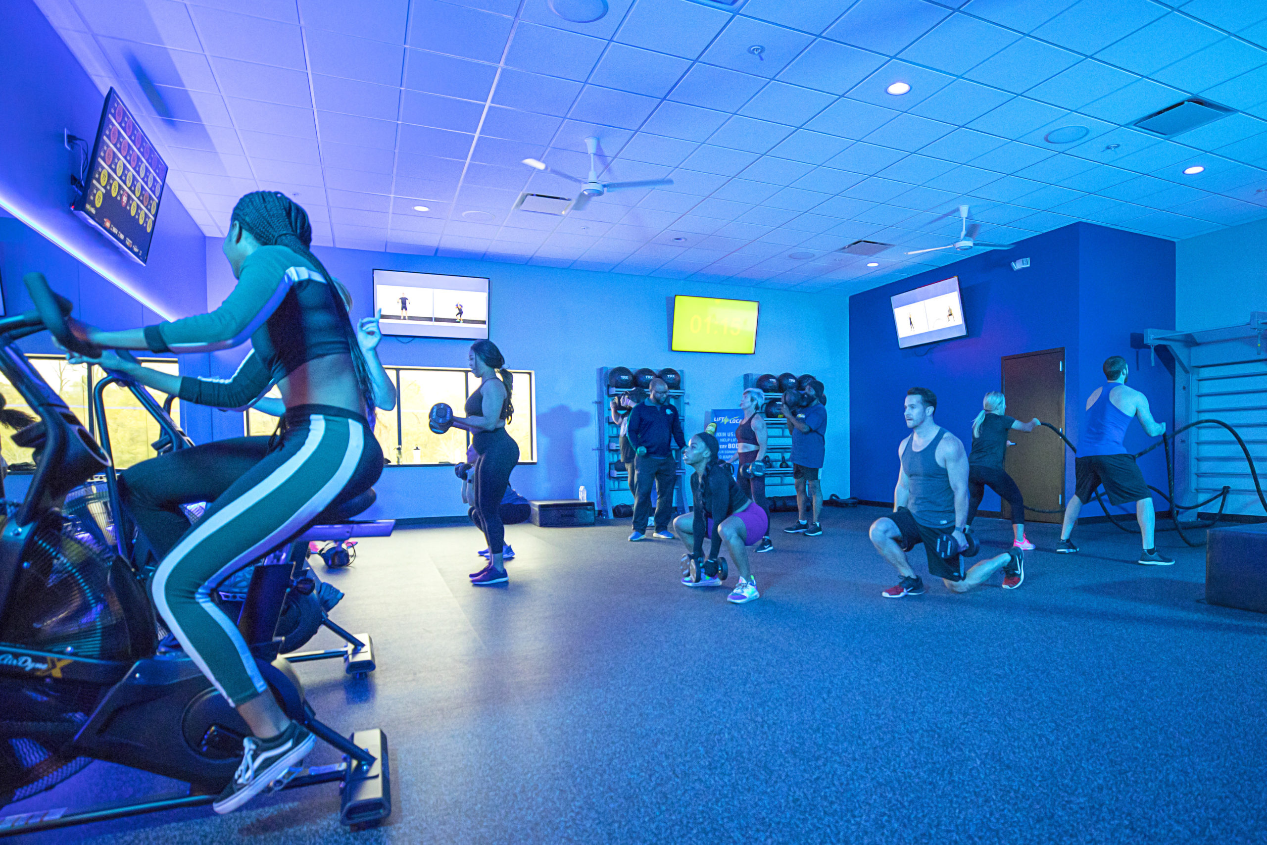Club Fitness patrons doing a series of exercises in the Pulse Studio